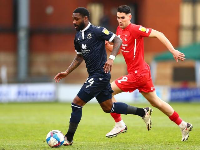 Morecambe midfielder Yann Songo'o has half his six-game suspension left to serve