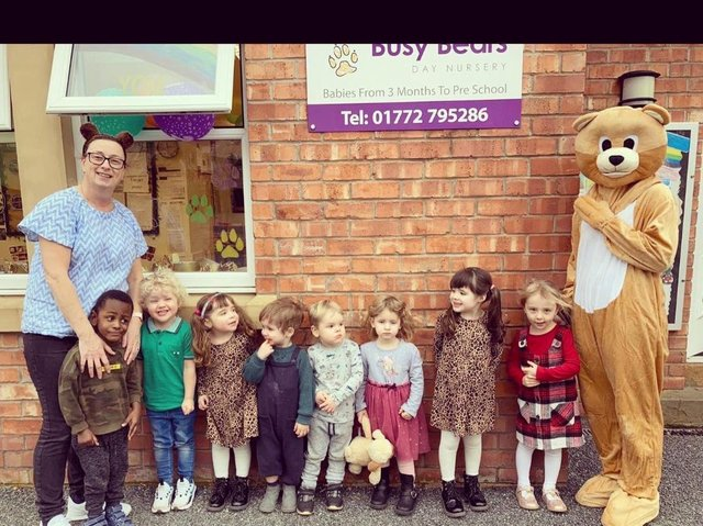 Busy Bears Nursery children with a real Busy Bear during 20th anniversary celebrations.
