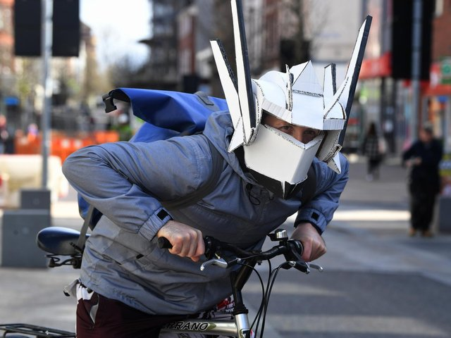 A cyclist with a unique take on safety with a home made helmet with built in face mask