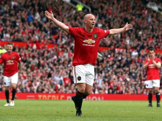Nicky Butt celebrates in a Manchester United's legends game.