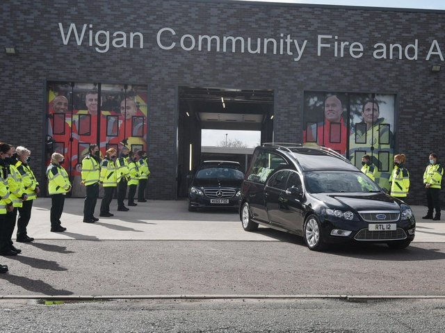 A guard of honour for Peter Millington's cortege at Wigan Fire and Ambulance Station