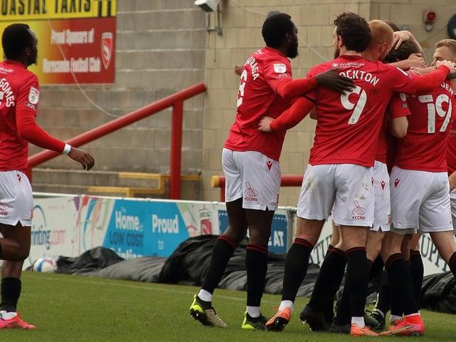 Morecambe celebrate Liam McAlinden's winning goal against Cheltenham Town last weekend
