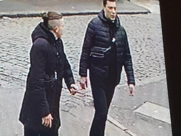 Tautvydas Kaluina, who is believed to be the shorter man on the left with the distinctive hair, is pictured with a taller man, who is believed to be the man seen on previously released CCTV running into the Tesco superstore in Hill Street for help after Mr Kaluina was bundled into a car and abducted