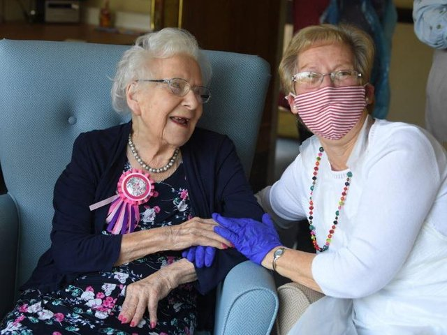 Pauline Archer holds her mums hand as she turns 101