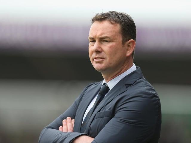 Morecambe boss Derek Adams saw his men lose at Cambridge United