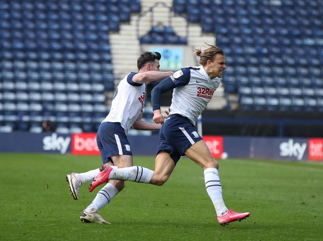 Preston North End goalscorer Brad Potts is pursued by Andrew Hughes as he runs to celebrate