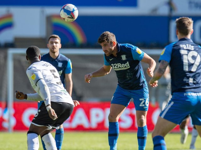 Ched Evans heads the ball on against Swansea City.