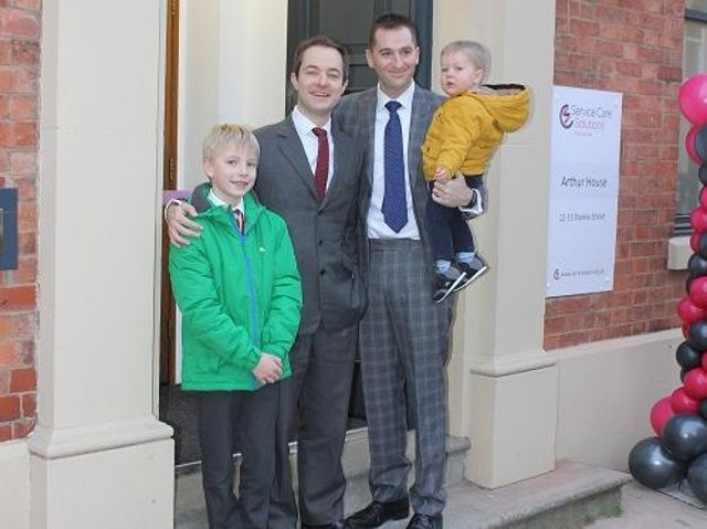 Richard Freye, left, and Chris Musgrove and their young sons