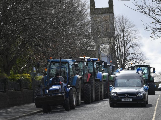 Tractors big and small join the funeral procession
