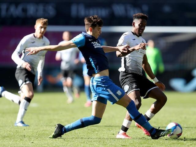 Preston North End defender Jordan Storey makes a challenge against Swansea at the Liberty Stadium