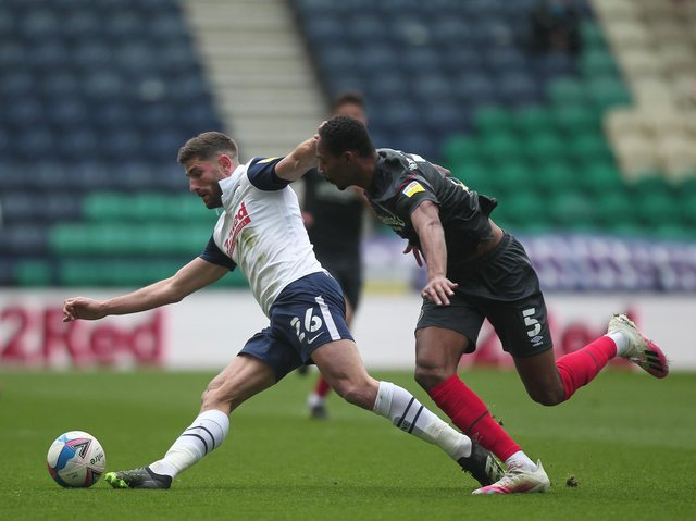 Ched Evans battles for the ball.