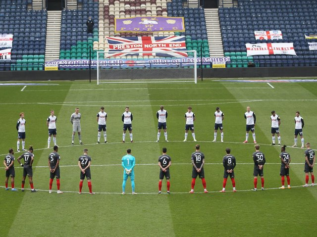 Preston North End and Brentford players observe a two minute's silence in honour of Prince Philip, Duke of Edinburgh
