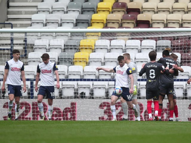 Andrew Hughes shows his frustration by kicking the ball away as Preston North End concede against Brentford at Deepdale