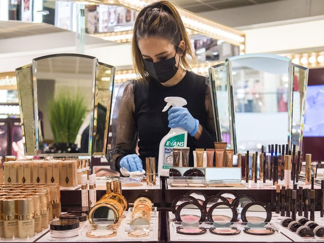 A John Lewis works cleans the Charlotte Tilbury counter at a Peter Jones store as they prepare for reopening on Monday. Picture: Kirsty O'Connor/Press Association