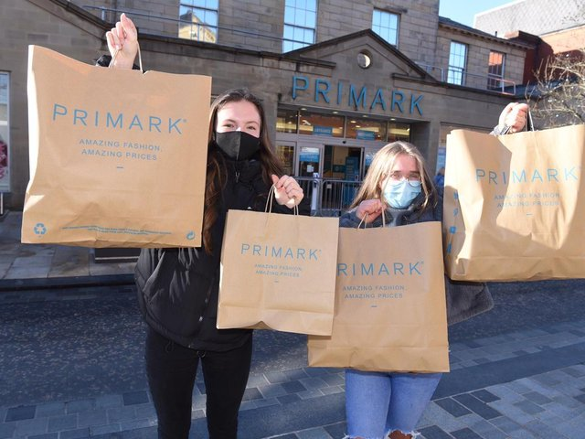 Shop 'till you drop: Customers outside the newly reopened Primark store in Preston