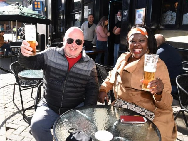 Catherine and David Scarfe enjoy an early morning drink at the Market Tavern.