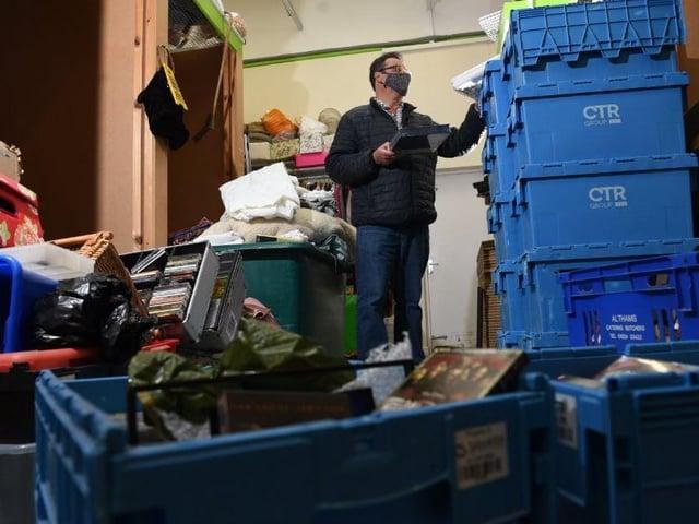Graham Strong sorts through donations at Barnardo's Charity Shop at Ashton