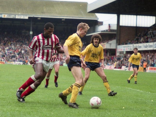 Preston North End's Lee Cartwright shields the ball against Stoke at the Victoria Ground, watched by Steve Harper