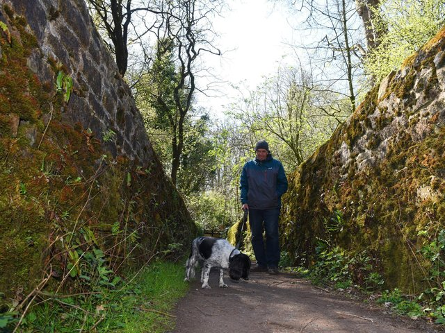 John Tracey and Molly walking on the cinder path