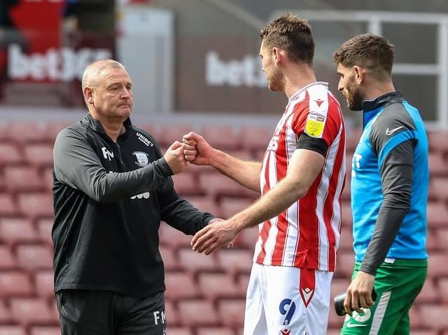 Preston North End interim head coach Frankie McAvoy fist-bumps Stoke striker Same Vokes at the final whistle