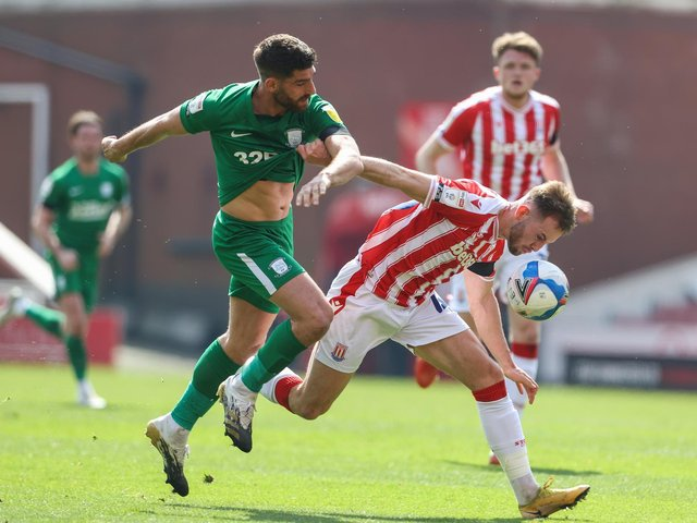 Ched Evans competes for the ball against Stoke
