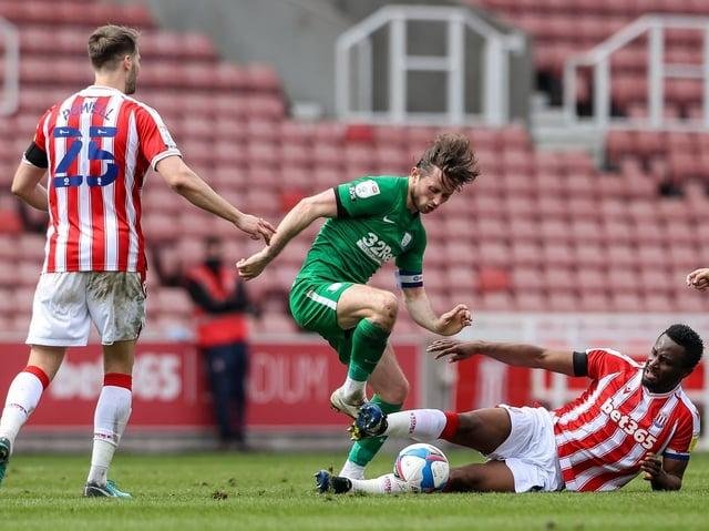 Preston North End skipper Alan Browne is challenged by Stoke John Obi Mikel