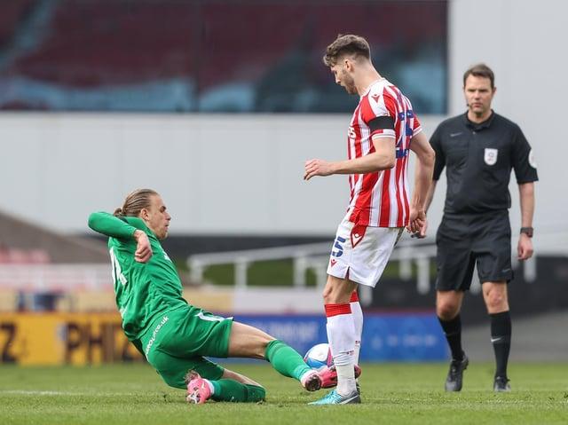 Preston North End's Brad Potts challenges Stoke midfielder Nick Powell