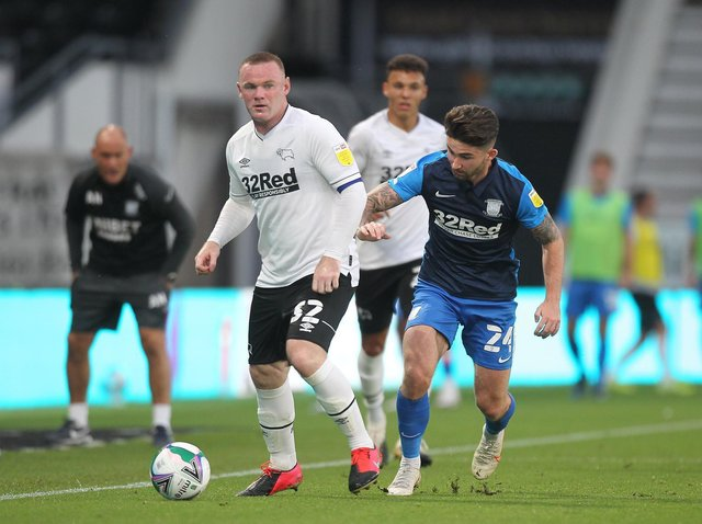 Wayne Rooney is tracked by Sean Maguire in Preston North End's victory over Derby in the Carabao Cup in September