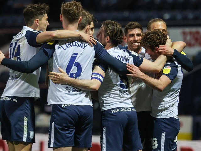 Preston North End's players celebrate Ryan Ledson scoring their third goal.