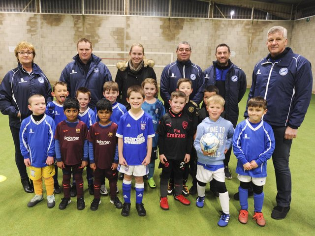 Sir Tom Finney Soccer Centre co-founders Kath Mason (far left) and Peter Mason (far right) with young footballers and coaches