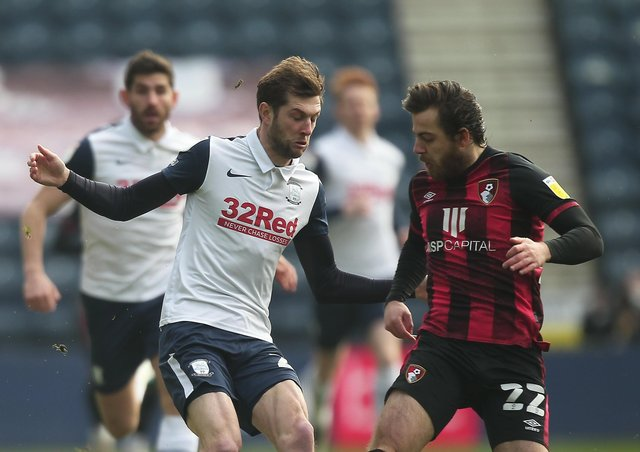 Tom Barkhuizen taking on former PNE man Ben Pearson during the game against Bournemouth