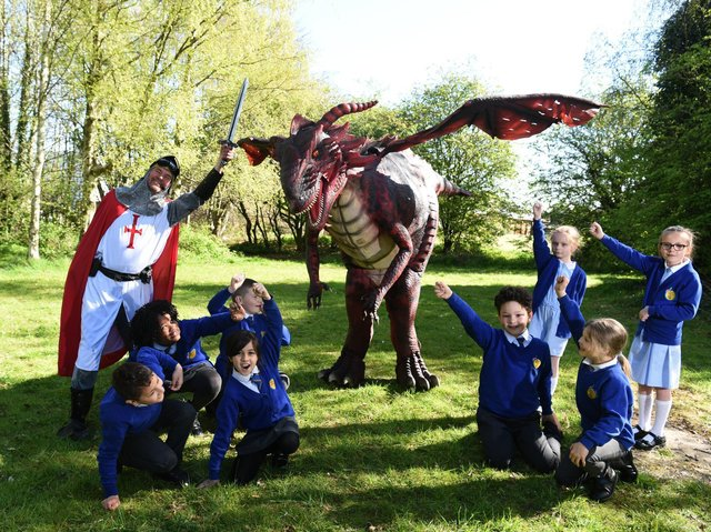 Pupils at Eldon Primary School with St George and the legendary dragon.