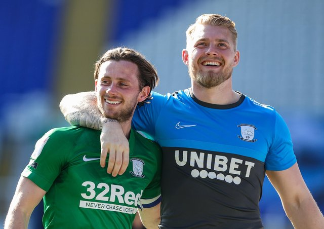 Preston's Alan Browne and Connor Ripley celebrate victory at the end of the match