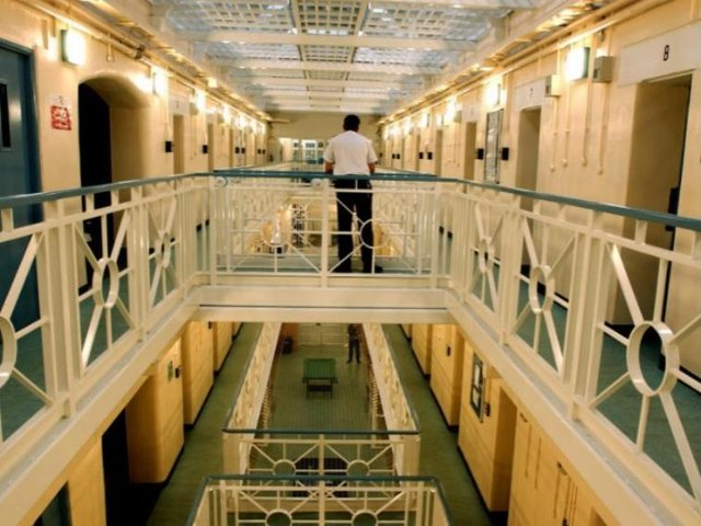 Inmates say they are under virtual lockdown as jail fights Covid outbreak.