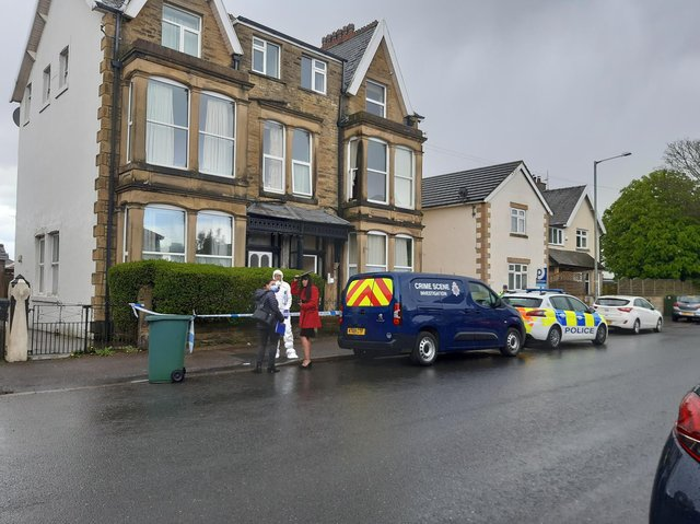 A property on Balmoral Road in Morecambe is cordoned off with police tape and there are crime scene investigators at the scene.