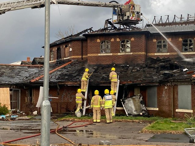 Pictures from the scene show firefighters using hose reels and an aerial ladder platform to fight the flames at Baffito's after a second fire in five months gutted the derelict building. Pic: @IanArmistead