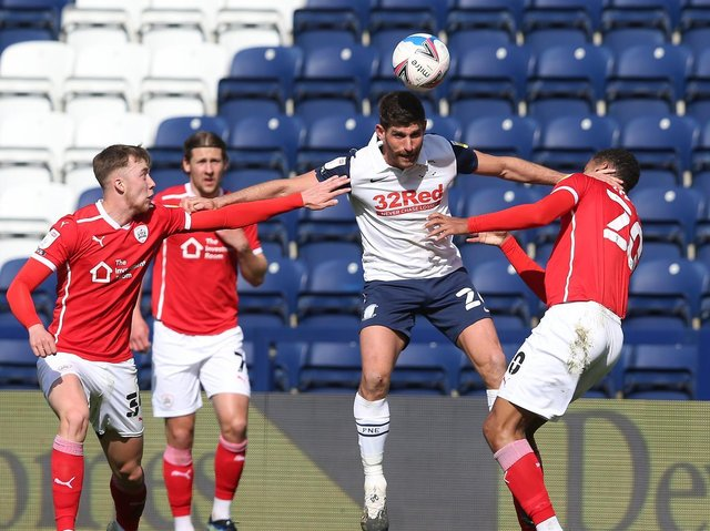 Preston North End striker Ched Evans challenges in the air against Barnsley at Deepdale