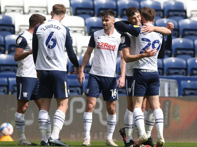 Jordan Storey is congratulated after opening the scoring against Barnsley