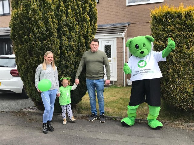 Quinn and her parents were thrilled to be met by Humphrey bear at the end of the 30 Miles My Way challenge