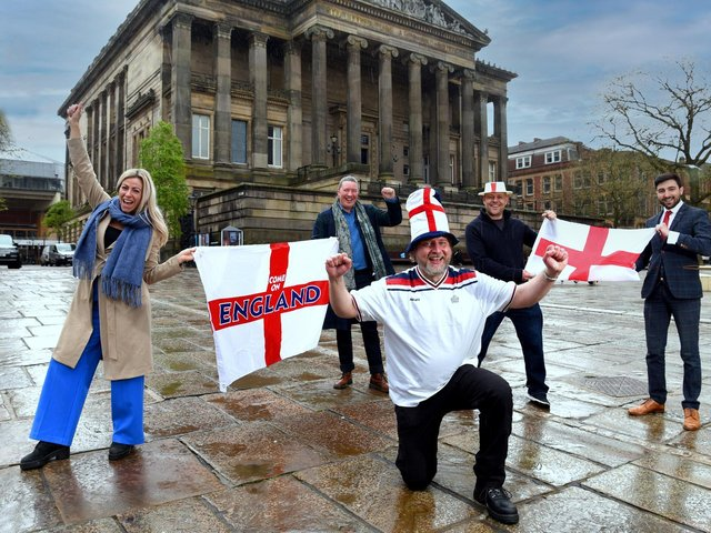 Football's coming home ... Mike Pixton, centre, with Serena Baxter, Paul Harrison, Paul Butcher and Richard Fontana on Preston's Flag Market