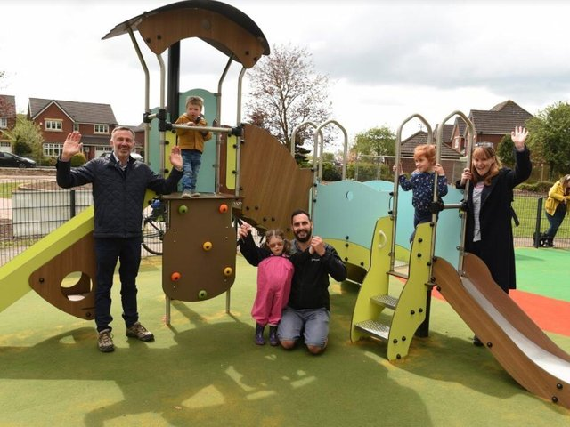 A dual slide is one of the new attractions at the revamped Bellis Way playground, a facility that Cllrs Matt Campbell (centre) and Damian Bretherton (left) have been campaigning for, along with local residents (image: Neil Cross)