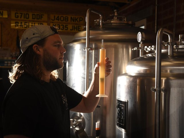 Ryan in his nano brewery, inside his garage