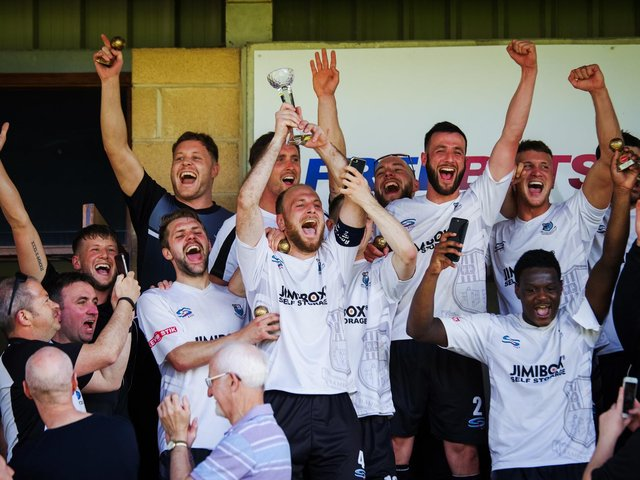 Matt Lawlor holds aloft the play-off final trophy after Brig won promotion from the NPL First Division North in 2018 (photo:Ruth Hornby)