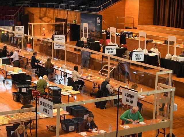 Socially-distanced vote-counters at work at the Guild Hall