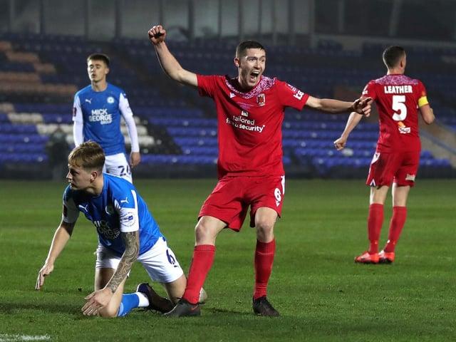 Lewis Baines celebrates scoring againstPeterborough in the FA Cup