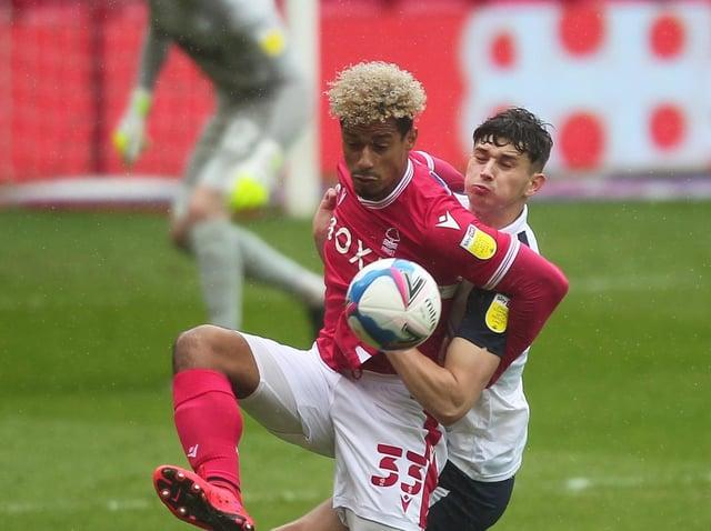 Preston North End defender Jordan Storey battles with Nottingham Forest striker Lyle Taylor
