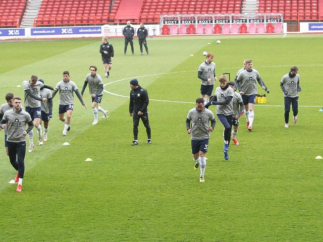 Preston North End warm up in Gentry Day t shirts ahead of their win over Nottingham Forest.
