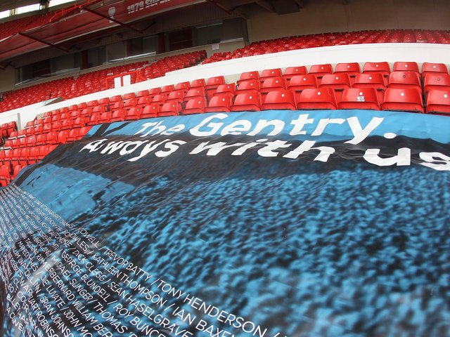 The Gentry flag was spread over seats in the empty away end at the City Ground
