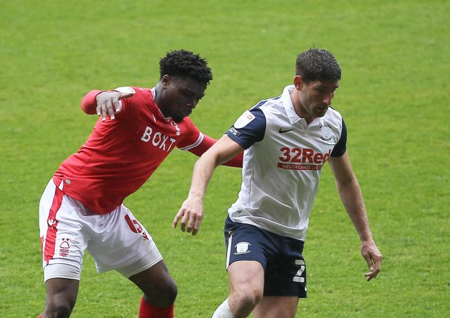 Preston North End's Ched Evans with Nottingham Forest's Loic Mbe Soh