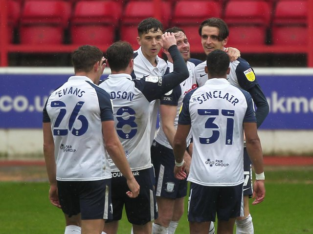Tom Bayliss celebrates with his team-mates after equalising for Preston North End against Nottingham Forest